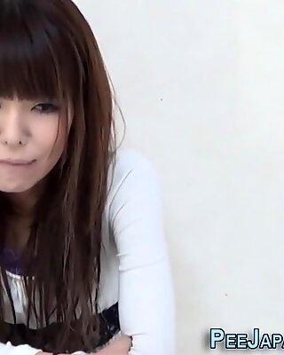 Asian hottie pees herself