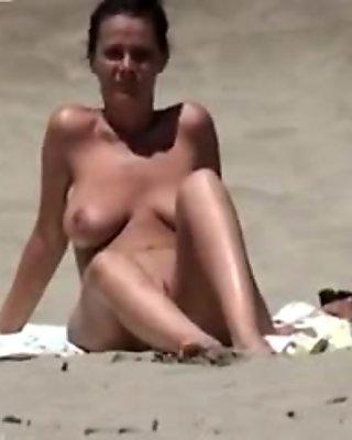 mature lady at cap d agde in nature's garb beach